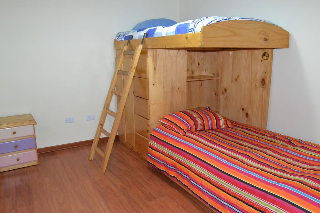 Trundle bed under bottom bed for extra person.