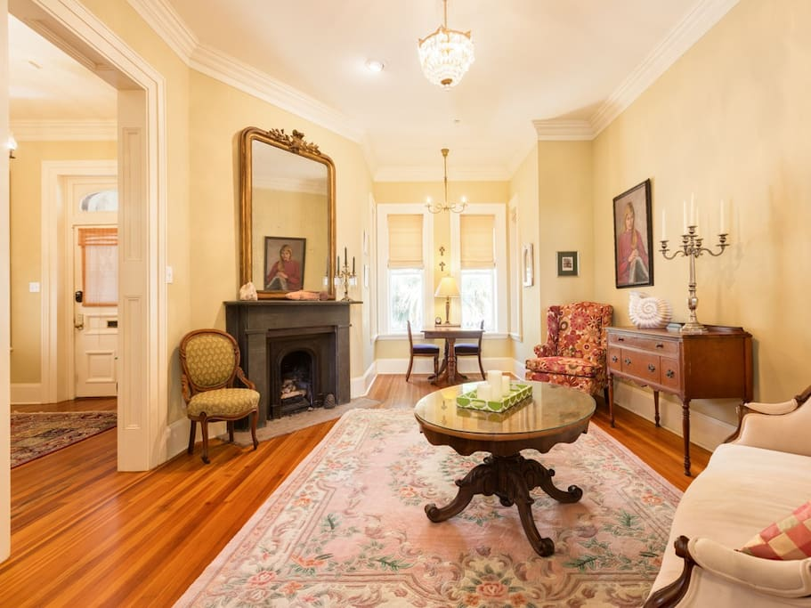This grand second living room is full of antique-style furnishings.