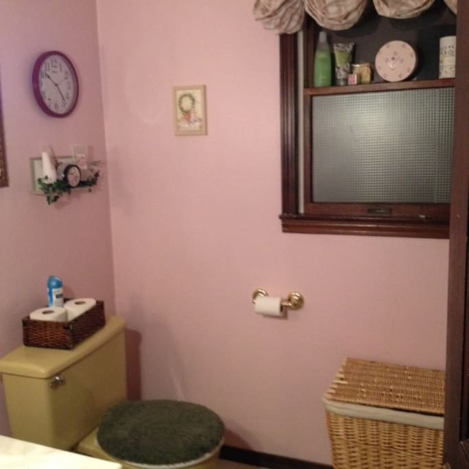 View of the full bathroom, with shower & tub located upstairs.