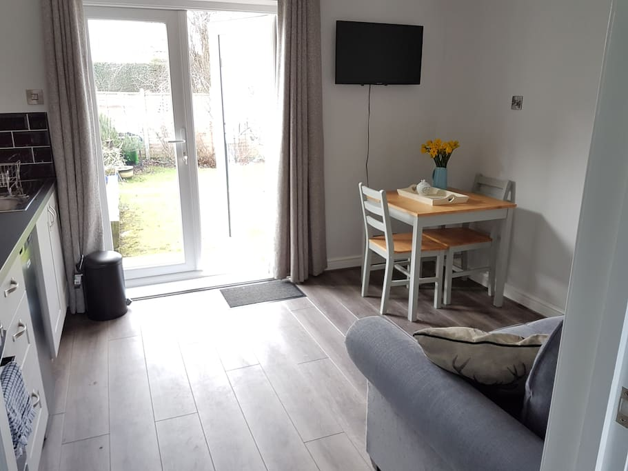 Separate lounge/breakfast area with TV, kitchenette and views on to pretty garden