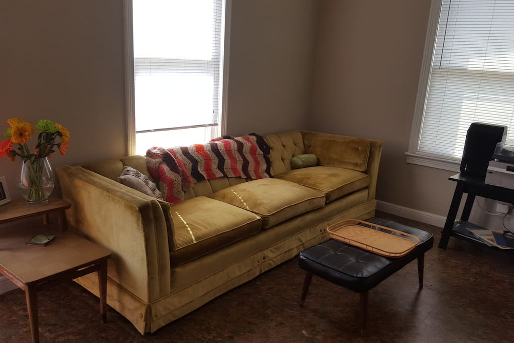 Very long, very comfy sofa that can accommodate a 3rd