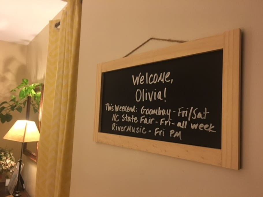 A chalkboard sign on your bedroom door welcomes you and shares local happenings