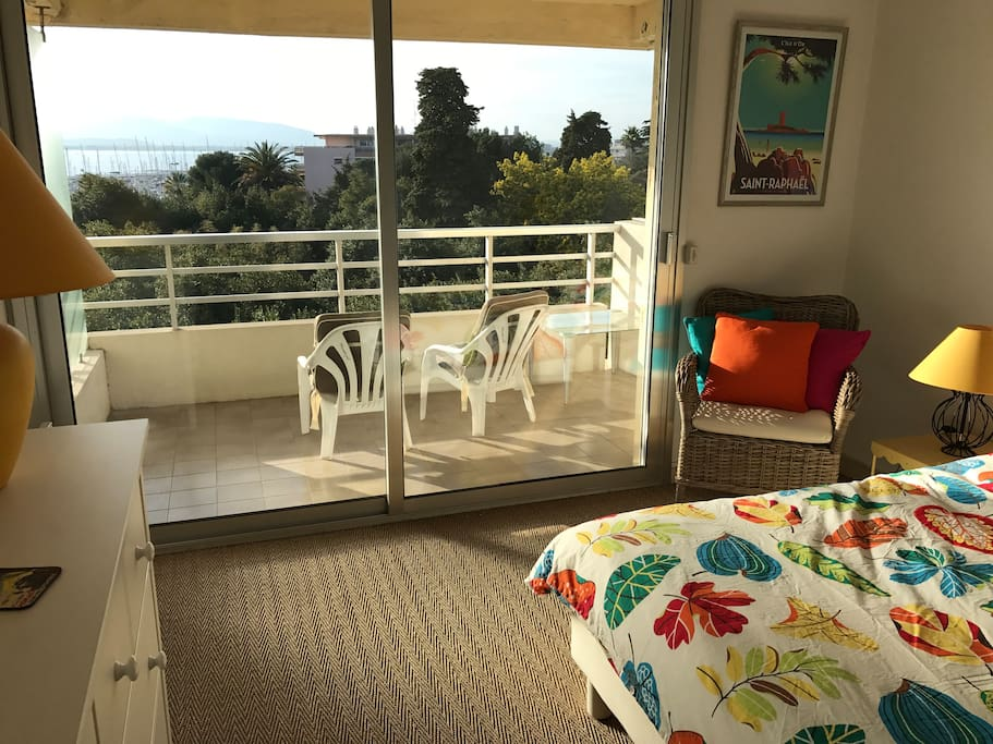Large bedroom with balcony overlooking the sea