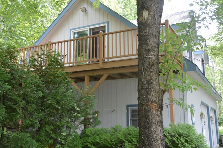 The balcony from your Burt Lake hideaway