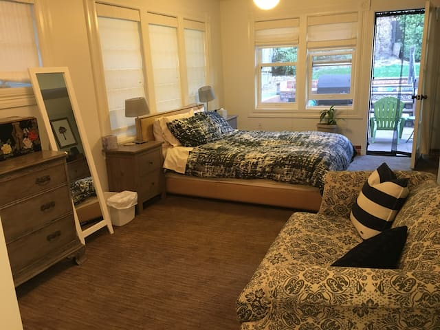 Master suite on garden level with direct patio & backyard access