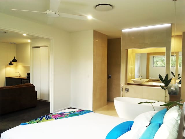 Beautiful open master suite with partitioning doors to private lounge.