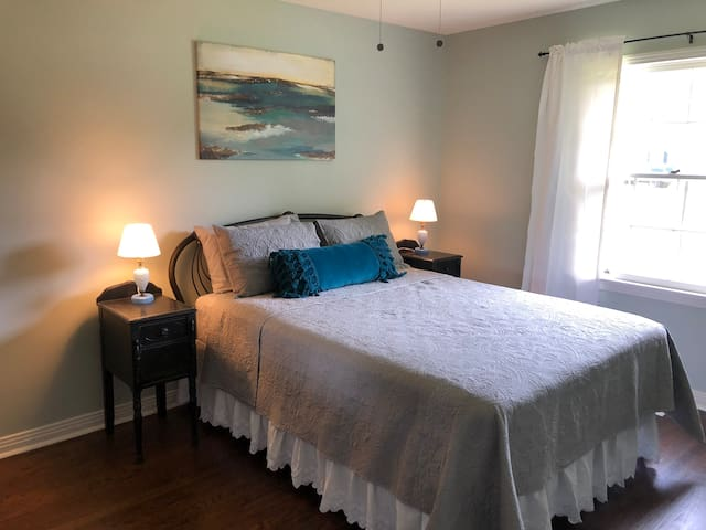 Brand New Queen Size Bed. The room also features black out curtains as well as a full closet. Iron and ironing board inside closet.