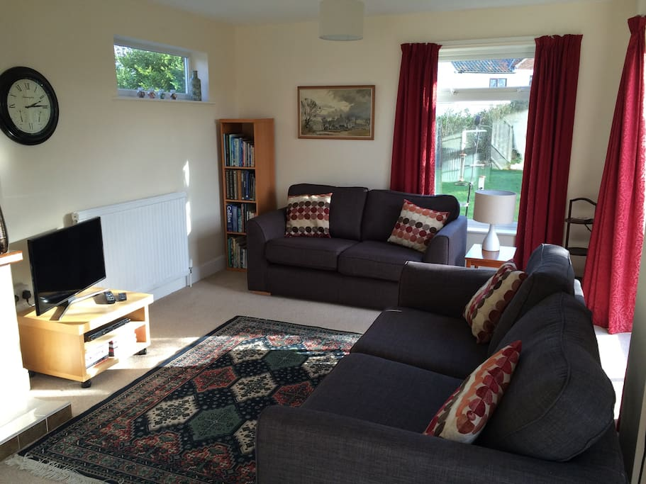 Bright living room with smart tv and DVD player