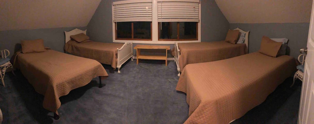 """""""Sunfish Room"""" with 4 twin beds."""
