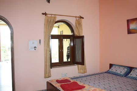 Room 204 in Family-run Ashram with Yoga & Ayurveda - Vrindavan