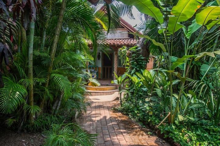 La Casita in a tropical garden beach paradise