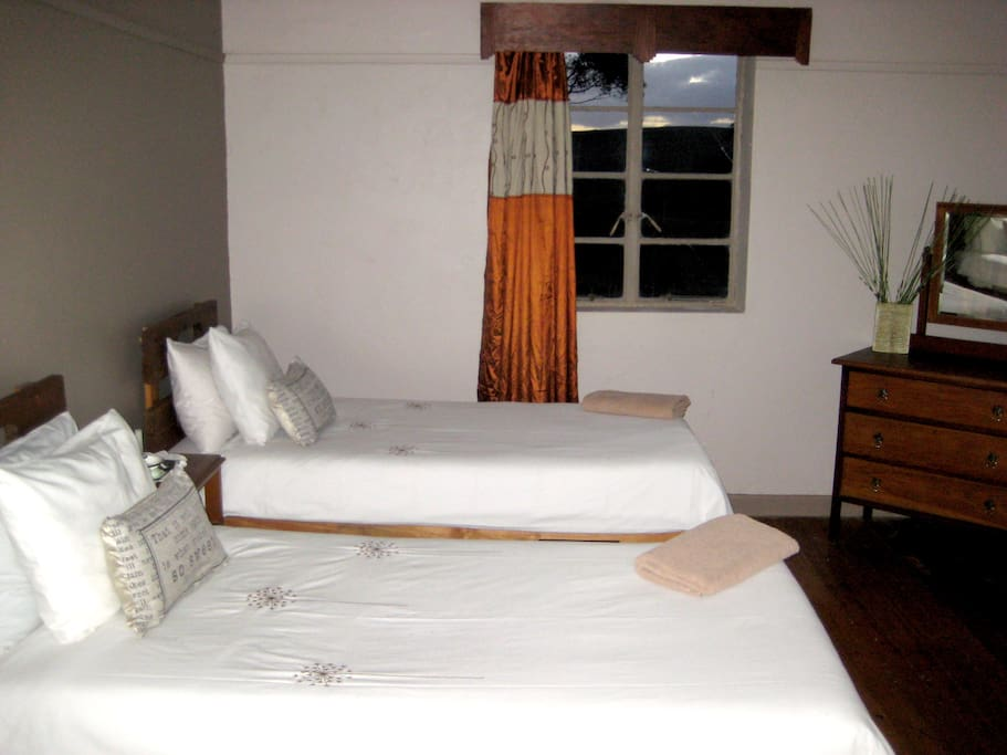 Room with single beds. An additional single bed can be added to either of the two rooms.