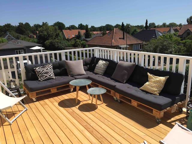 Rooftop terrace with lounge furniture and an amazing undisturbed view of the neighborhood.