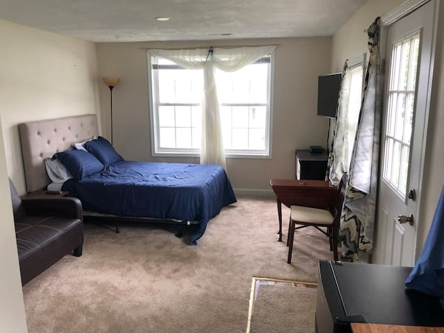 New Full bed, Big screen cable TV with Netflix, dresser, end table, fold down leaf dining table and folding chairs, new carpet and paint.