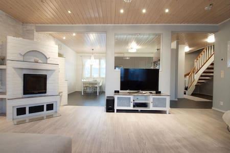 Modern and luminous Scandinavian house with sauna