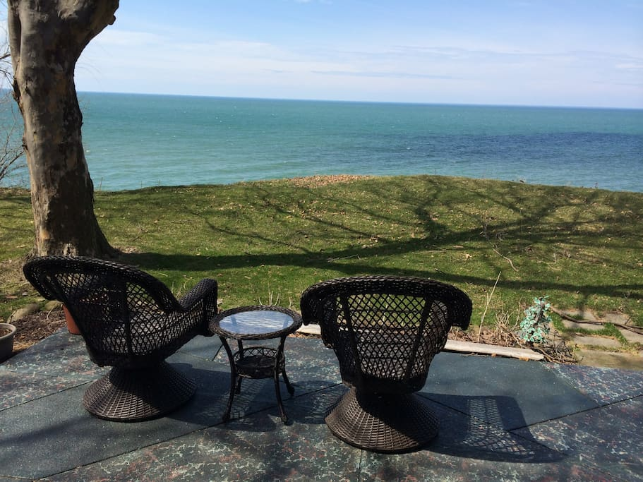 Back porch with lake view & view of Cleveland skyline on clear days. 6 chairs available - perfect for an outdoor breakfast, lunch or dinner!
