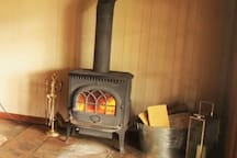 Cosy up to the combustion fire in living area