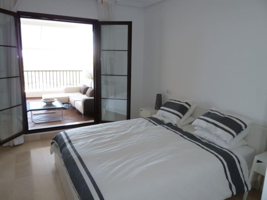 Master bedroom with doors opening to terrace