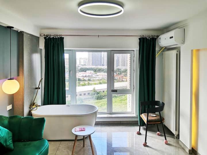 幸福时刻 哈西站哈西万达时客幸福浴缸投影大床房