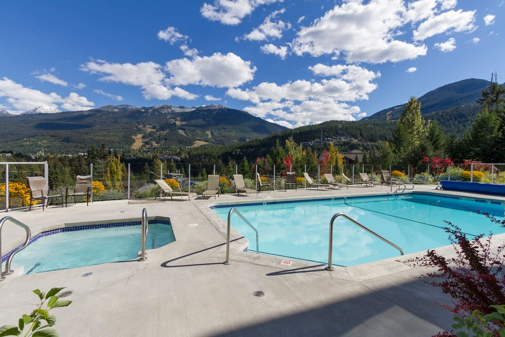 Spectacular outdoor heated pool and hot tub with unobstructed views of Whistler and Blackcomb