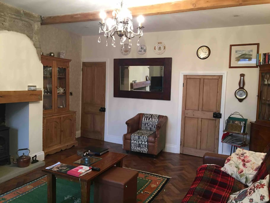 Relax in this spacious living room full of character features. Ceiling beams, restored pine doors, a comfortable leather sofa, which extends to form an extra bed, and a gas fired stove make your stay here at Dyer's Cottage really enjoyable.