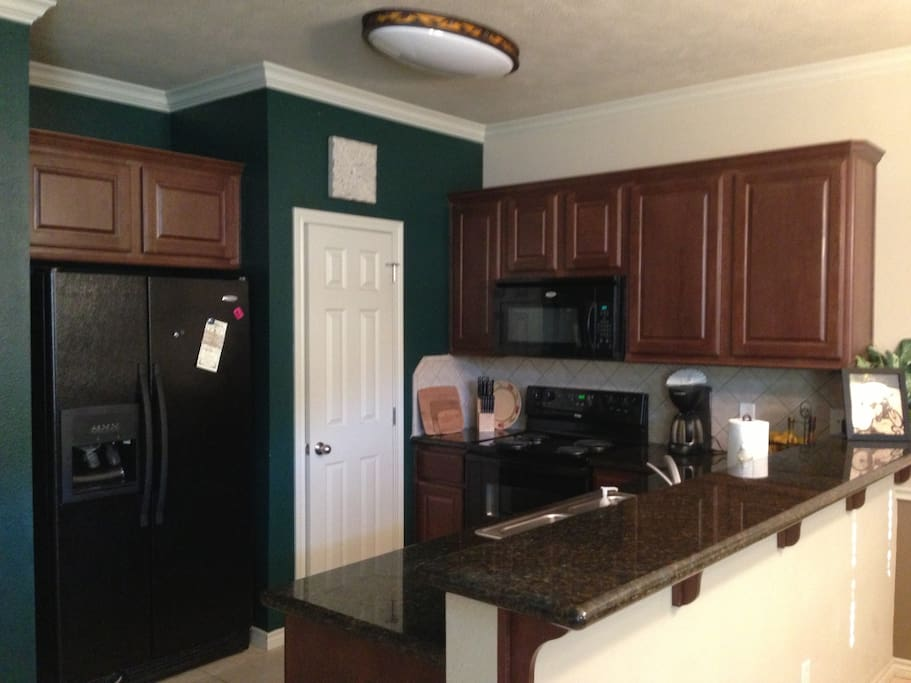 Spacious kitchen with all necessary appliances for cooking.