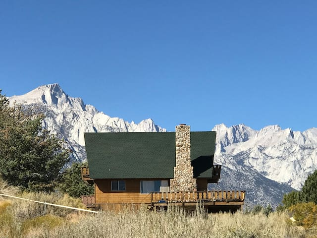 View of the house and the Sierra behind including Mt. Whitney and Mt. Wallace.