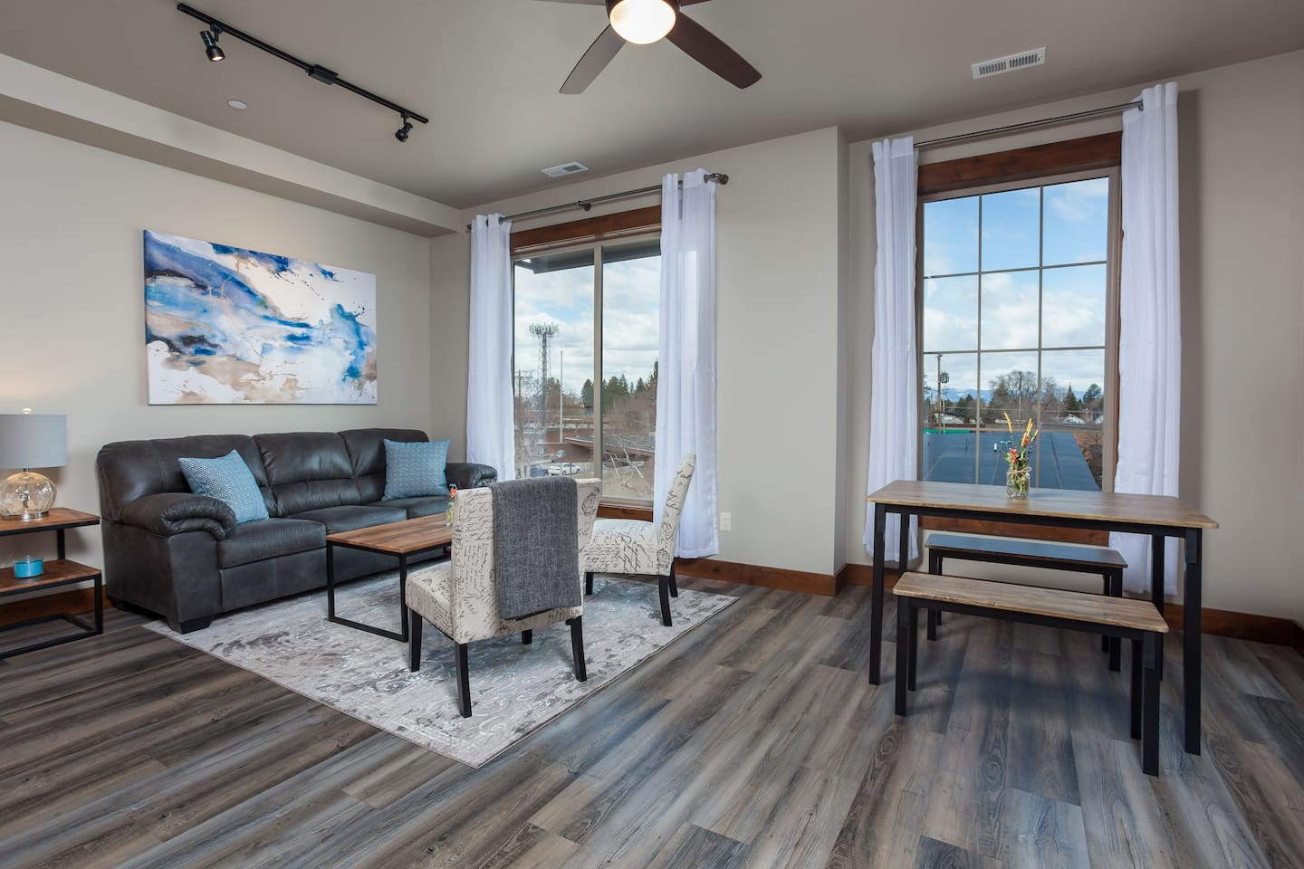 Large living and dining area open and bright with views of Whitefish Mountain and beautiful sunsets.