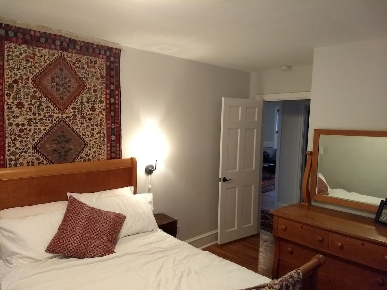 Turkish tapestry and antique furniture throughout. This is bedrooom one.