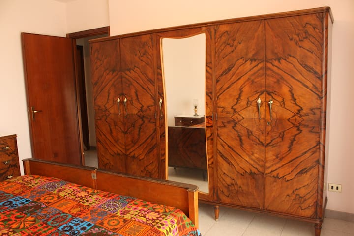 The room is very luminous and it includes a lovely wooden vintage wardrobe.