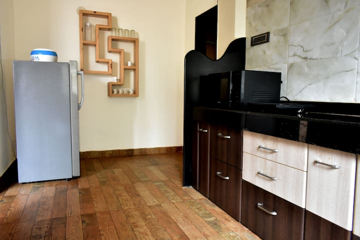 Kitchen equipped with Refrigerator, Induction Plate and Microwave