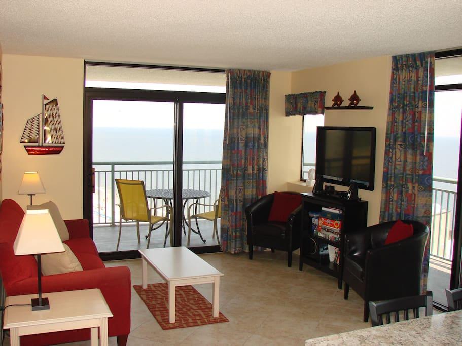 Wraparound balcony and ceiling-high windows bring the ocean closer.