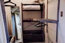Large walk-in closet provides lots of space to unpack.  A full-length mirror and clothes bin are provided.  The clothes steamer, extra linens and pillows, and pack-n-play are also stored here.