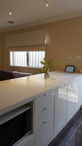 A very spacious breakfast bar, plenty of storage, wall USB charging points to charge multiple devices, well lit
