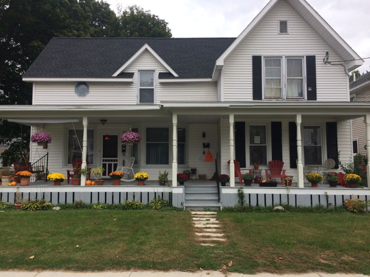 The large front porch is a comfortable place to enjoy the evenings. This is a two unit house and ours is the one on the right.