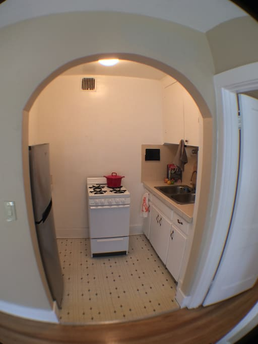 Small but convenient kitchen.  iPad mounted on wall for recipes/music.  Coffee etc. is stocked.