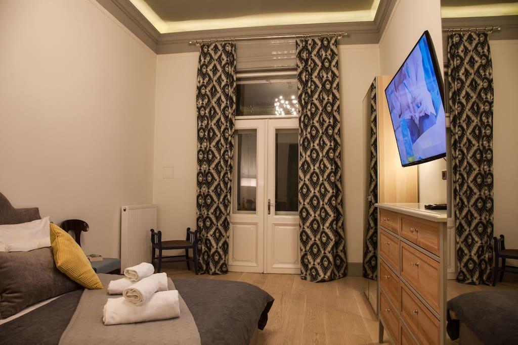 Main bedroom with access to balcony