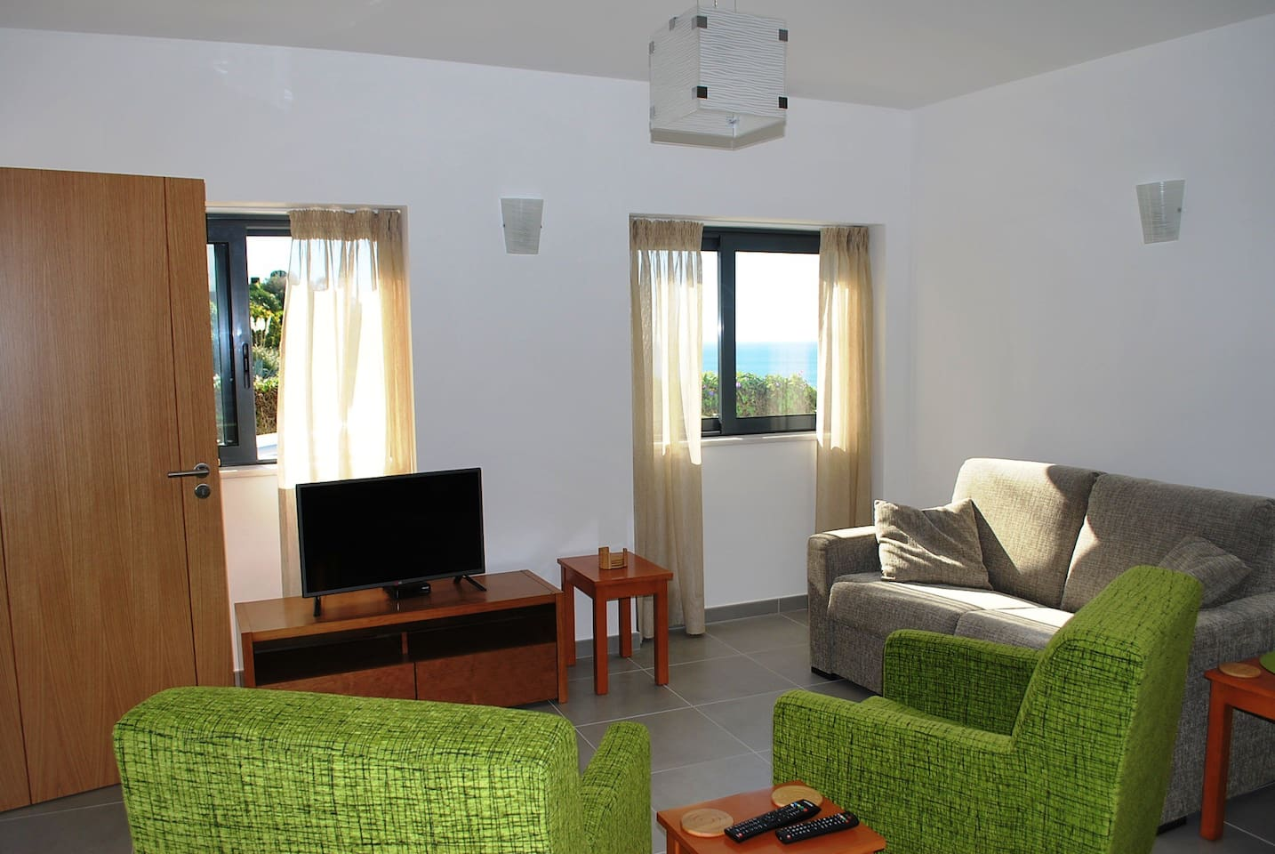 Lounge area with double bed settee, flat screen tv with Uk channels and wifi.