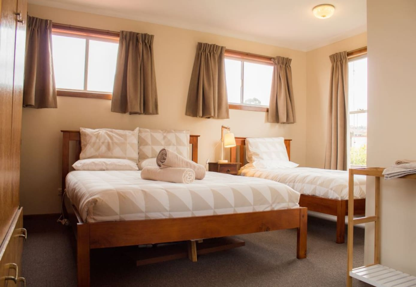 Spacious bedroom with 1 x queen size and 1 x single beds. Electric blankets on each bed.