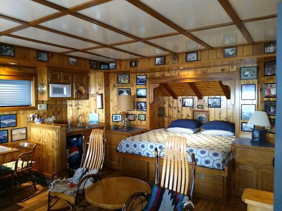 Inside the Captain's Cabin with a King size bed and rocking chairs.