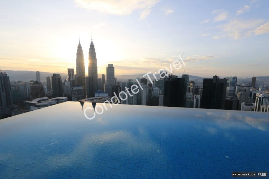 infinity-pool sun rise view over KLCC Twin Tower...