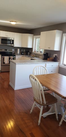 Kitchen (1st FLR)- All new appliances, cooking and dinning ware.