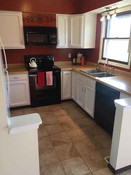 kitchen fully equipped with cooking necessities and new appliances