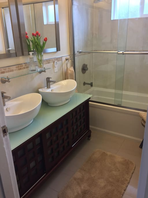 The bathroom has a full bath, shower and 2 sinks.  There is also a separate 1/2 bath. Both are shared with other guests.