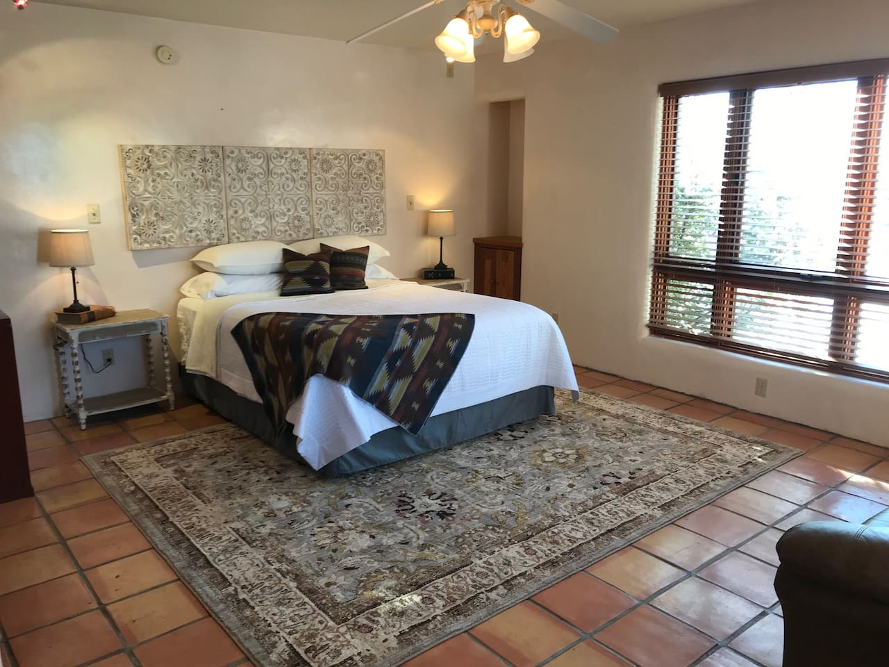 Large sleeping area with lots of natural light.  Queen bed and sitting area.