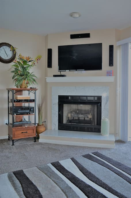 Fireplace, large television, stereo with surround sound, including outdoor speakers.