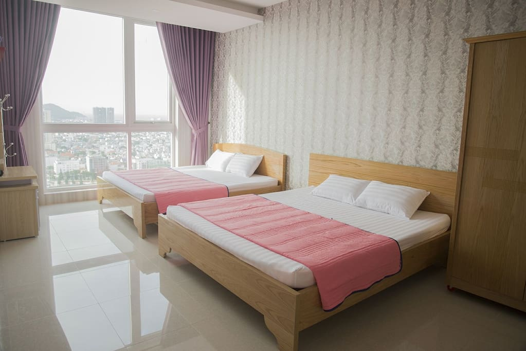 master bedroom with two king size beds