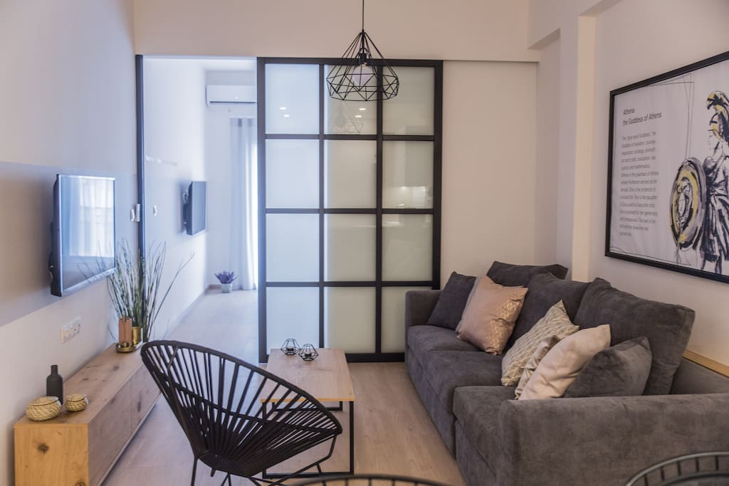 Comfortable living room with big smart flat screen TV connected to Netflix channels.