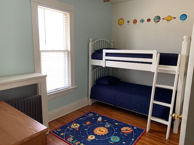 This is our third bedroom with bunk beds. These are two regular sized twin beds. Not your traditional smaller  bunk bed mattresses.