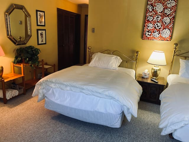 Room #4 is a large room with two double beds